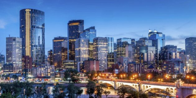 Calgary skyline at night with Bow River and Centre Street