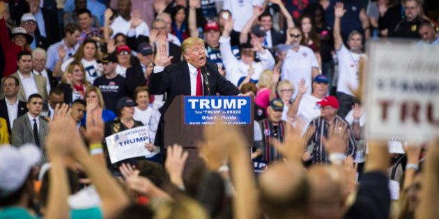 ORLANDO, FL - MARCH 5: Republican presidential candidate Donald Trump guides everyone to pledge to vote for him as he speaks during a campaign event at the CFE Federal Credit Union Arena in Orlando, FL on Saturday March 05, 2016. (Photo by Jabin Botsford/The Washington Post via Getty Images)