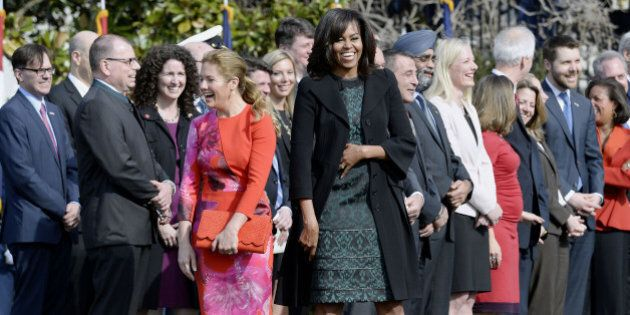 First Lady Michelle Obama, right, and Sophie Gregoire-Trudeau share a laugh during a welcoming ceremony...