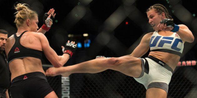 LAS VEGAS, NV - MARCH 5: (R-L) Miesha Tate kicks Holly Holm during their women's bantamweight championship...