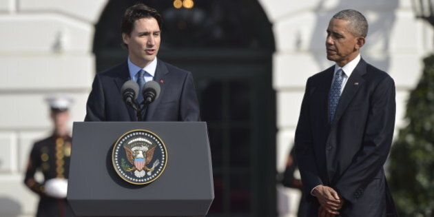 US President Barack Obama and Canada's Prime Minister Justin Trudeau take part in a welcome ceremony...