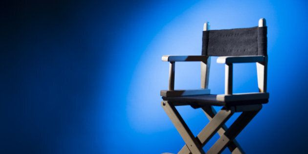 dramatic lit director's chair