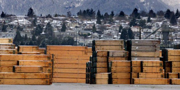 Piles of softwood lumber destined for export, are stacked at a Richmond, B.C., Canada lumberyard, March...