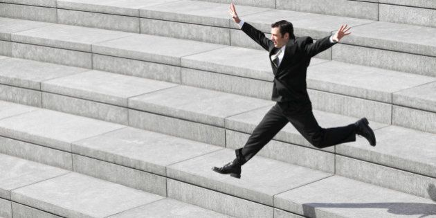 Businessman leaping on
