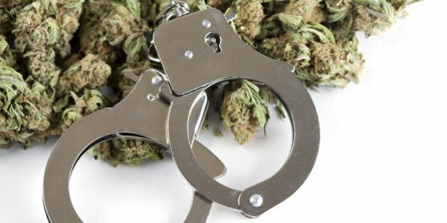 Marijuana and handcuffs conceptual image for criminal aspects of the