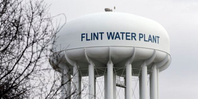 FILE - This Feb. 5, 2016 file photo shows the Flint Water Plant tower in Flint, Mich. Michigan, seeking...