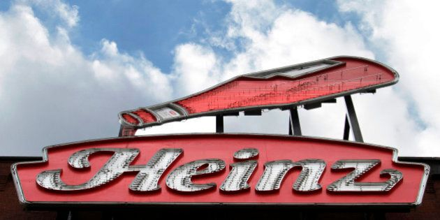 This photo shows a neon Heinz ketchup sign on the side of the Senator John Heinz History Center in Pittsburgh, Wednesday, March 25, 2015. H.J. Heinz Co. is buying Kraft Foods Group Inc., creating what the companies say will be the third-largest food and beverage company in North America, the companies announced Wednesday. (AP Photo/Gene J. Puskar)