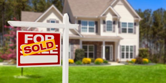 Sold Home For Sale Real Estate Sign and Beautiful New House.