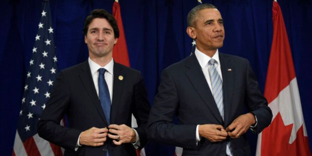U.S. President Barack Obama, right, and Canadas Prime Minister Justin Trudeau stand up following their...
