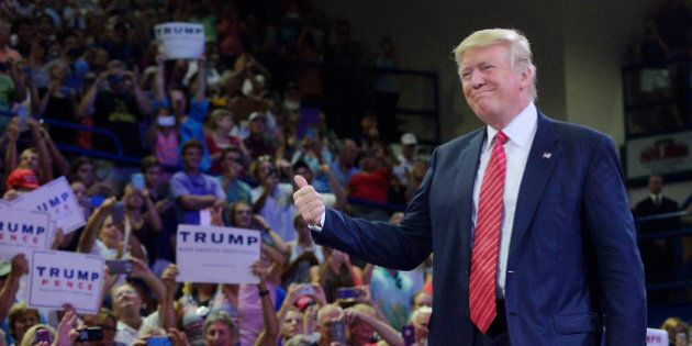 WILMINGTON, NC - AUGUST 9: Republican presidential candidate Donald Trump thumbs-up the crowd during...