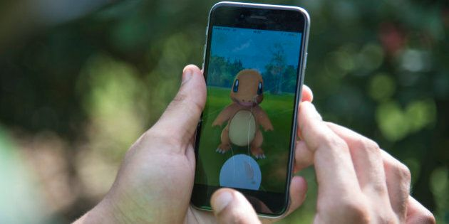In this Friday, July 22, 2016 photo, a Pokemon Go player attempts to catch Charmander, one of Pokemon's...