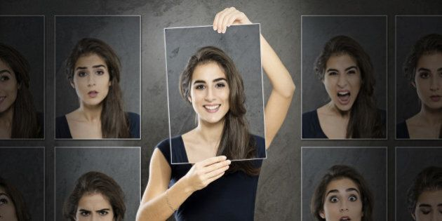 Woman holding photo in front of her face