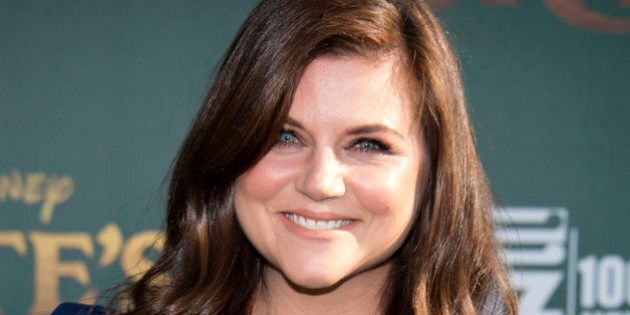 Actress Tiffani Thiessen attends the Disney premiere of 'Pete's Dragon' at El Capitan Theater in Hollywood,...