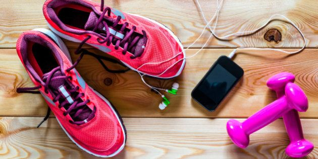 sneakers, dumbbells and other fitness accessories