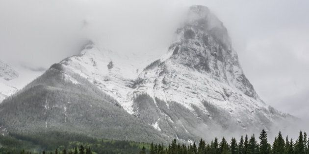 Ha Ling Peak is visible as the clouds from a snow storm is lifting. Ha Ling peak is part of Mount Lawrence...