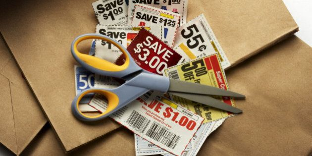 Savings coupons and scissors shot on shopping bags with soft drop