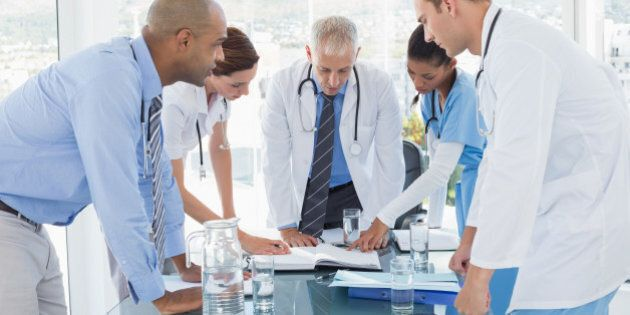 Team of doctors having a meeting in the meeting