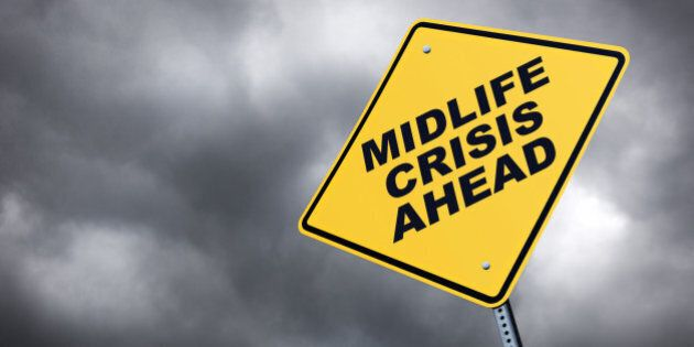 A road sign warning of a midlife crisis ahead .To see more road signs click on the link