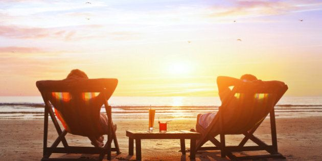 happy couple enjoy luxury sunset on the beach during summer