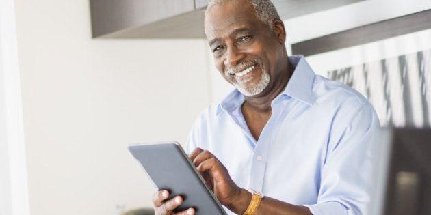 USA, New Jersey, Jersey City, Portrait of senior man using digital tablet in