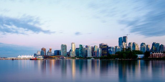 Vancouver skyline at sunset as seen from Stanley Park, British Columbia,