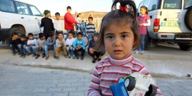 Syrian Refugee children are pictured at the refugee camp in Osmaniye on December 15, 2015.Turkey is home...