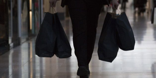 A shopper carries bags from a Zara fashion store, operated by Inditex SA, inside the Westfield London...