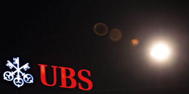 A sign sits illuminated on the roof of the UBS Group AG headquarters in Zurich, Switzerland, on Wednesday,...
