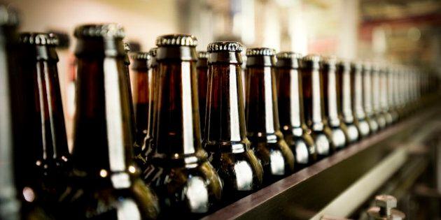Capped beer bottles in the filling