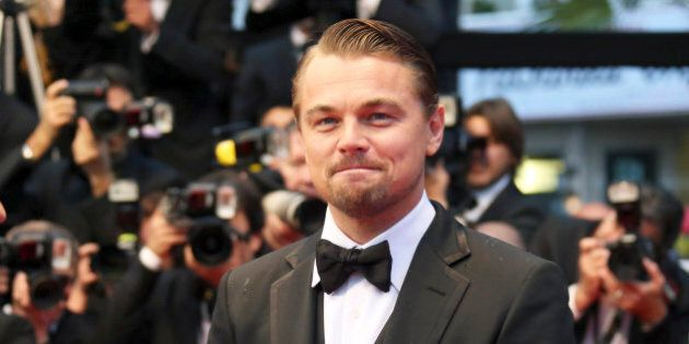 Cast member Leonardo DiCaprio arrives on the red carpet for the screening of the film 'The Great Gatsby'...