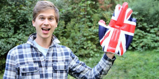 Man waving with a novelty Union Jack