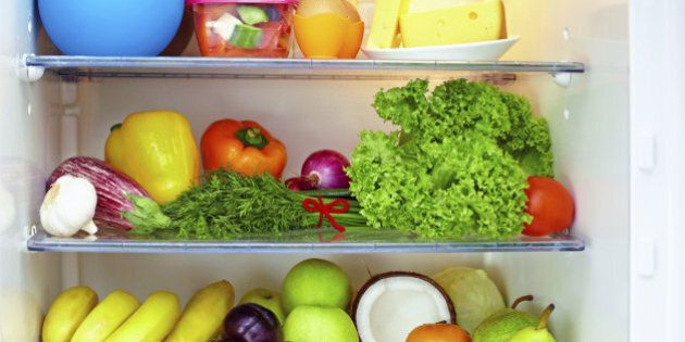 refrigerator full of healthy food. fruits and