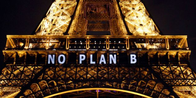 PARIS, FRANCE - DECEMBER 11: The slogan 'No Plan B' is projected on the Eiffel Tower as part of the World...