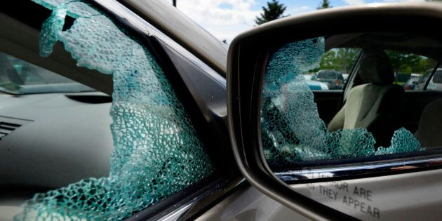 PORTLAND, ME - JUNE 10: A broken window on a car parked at the a park and ride on Marginal Way in Portland...