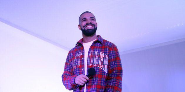 TORONTO, ON - NOVEMBER 25 - Toronto Rapper Drake addresses media in a 'Hotline Bling' installation at...