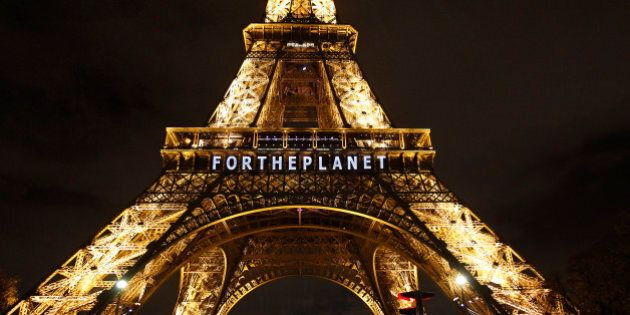 PARIS, FRANCE - DECEMBER 11:  The slogan 'For the planet' is projected on the Eiffel Tower as part of the World Climate Change Conference 2015 (COP21) on December 11, 2015 in Paris, France. COP21 President Laurent Fabius unveiled the final draft text of a global climate agreement of negotiations in Paris.  (Photo by Chesnot/Getty Images)