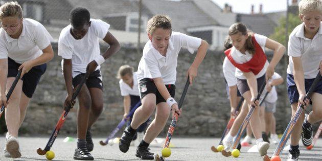 school children playing hockey