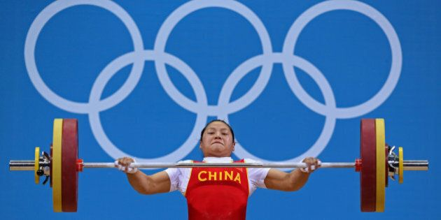 China's Xueying Li lifts 108 Kg on snatch setting new Olympic record on the women's 58Kg Group A weightlifting competition at the London 2012 Olympic Games July 30, 2012.                  REUTERS/Stefano Rellandini (BRITAIN  - Tags: SPORT OLYMPICS SPORT WEIGHTLIFTING TPX IMAGES OF THE DAY)