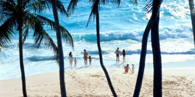 Couples and children (3-10) on beach, elevated view, Barbados