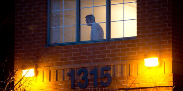 TORONTO, ON- FEBRUARY 5:A man looks out of a hallway window after Friday's tragic fire on the 5th floor...