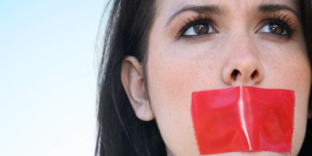 Woman With Red Tape Over Her Mouth Unable To