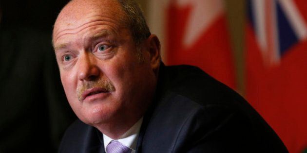 British Columbia Finance Minister Mike de Jong speaks during a news conference with Canada's Finance...