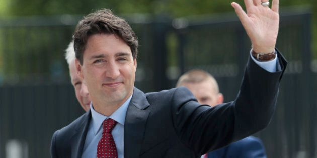 Canadian Prime Minister Justin Trudeau arrives at the NATO summit in Warsaw, Poland, Friday, July 8, 2016. Starting Friday, US President Barack Obama and leaders of the 27 other NATO countries will take decisions in Warsaw on how to deal with a resurgent Russia, violent extremist organizations like Islamic State, attacks in cyberspace and other menaces to allies' security during a summit described by many observers as NATO's most crucial meeting since the 1989 fall of the Berlin Wall.(AP Photo/Markus Schreiber)