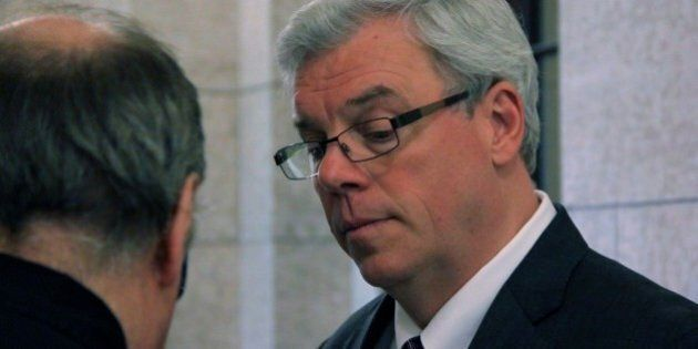 While walking through the Manitoba Legislative Assembly, I walked passed Premier Greg Selinger, who was in the midst of a media scrum with a group of local reporters.