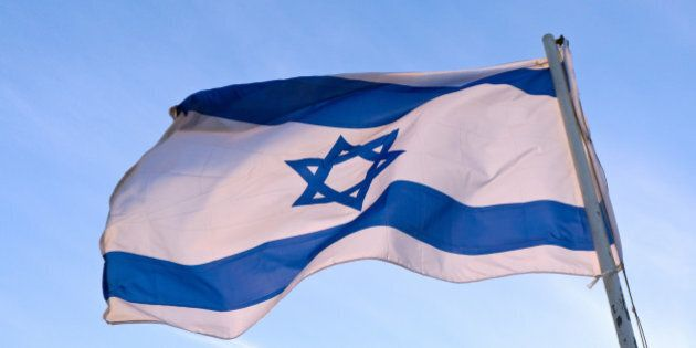Low angle view of an Israeli Flag fluttering,