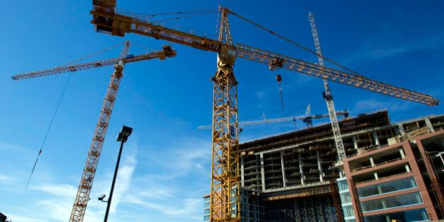 Cranes stand at a condominium construction site in downtown Vancouver, British Columbia, Canada, on Wednesday,...