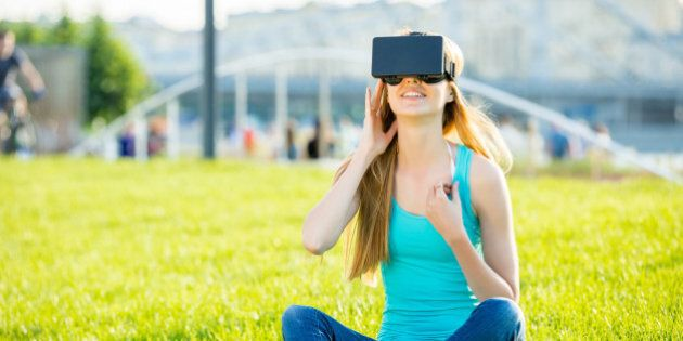 Girl with pleasure uses head-mounted