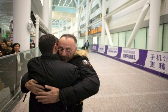 Syrian Refugee Families Arrive At Toronto Airport As Sponsors