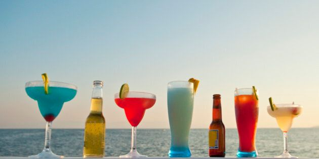 row of cocktails on boat rail
