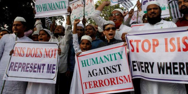 Indian Muslims shout slogans during a protest against ISIS, an Islamic State group, and the Nov. 13 attacks...
